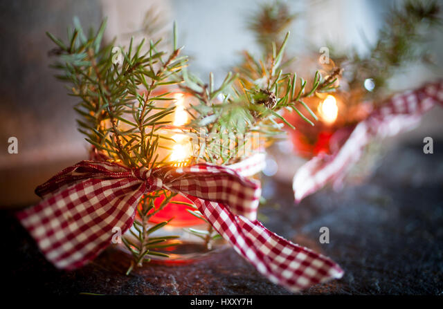Christmas candles with pine branches and ribbon - Stock Image