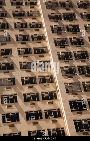 Tower block of flats with air conditioners on each window - Stock-Bilder
