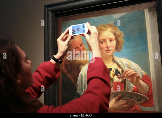 Moscow, Russia. 19th June, 2014. A visitor takes a photo of a Bearded Man and a Woman with a Parrot Unrequited Love - Stock Image