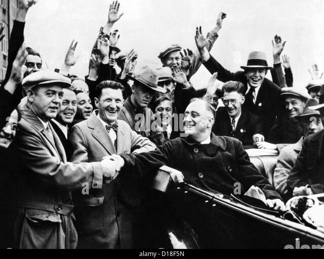 Franklin Roosevelt in the back seat of his car, surrounded by cheering citizens. 1930s. (CSU_ALPHA_33) CSU Archives/Everett - Stock Image
