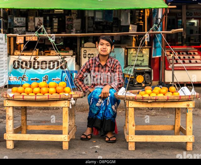 Street seller at traditional food market Rangoon Yangon Burma Myanamar - Stock-Bilder