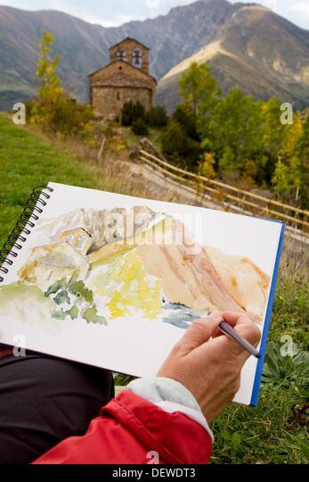 Man painting a watercolor  Chapel of Sant Quirze  Durro  Boi - Taull Valley. Alta Ribagorça, Lleida province, - Stock-Bilder