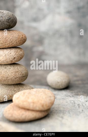 Organic stone in a gray toned studio still life environment. - Stock Image