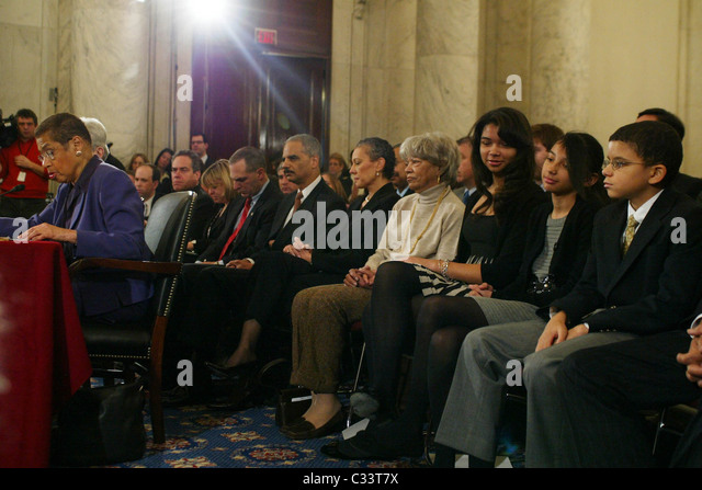 Senator Dianne Feinstein, Eric Holder, and family The Senate Judiciary Committee hearing for Eric Holder, President - Stock Image
