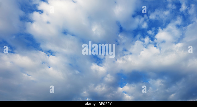 White cumulus clouds in the summer blue sky - Stock Image