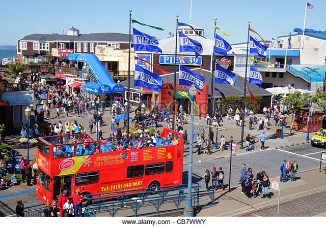 San Francisco California The Embarcadero Pier 39 waterside recreation area Fisherman's Wharf entrance busy plaza - Stock Image