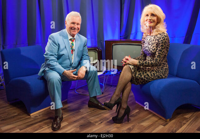 Walsall, West Midlands, UK. 20 March 2015. David Hamilton (L) with English pop singer Julie Rogers at a recording - Stock Image