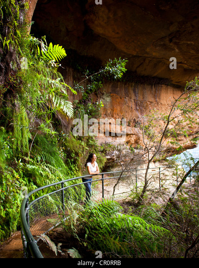 Young woman on the National Pass Trail in the Blue Mountains, Australia - Stock Image