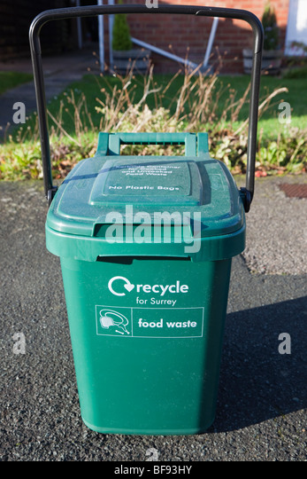 England, UK, Britain. Green kerbside recycling bin for home food waste waiting for collection outside - Stock Image