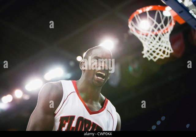 Basketball player shouting - Stock Image