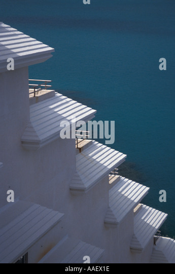 Bermuda Architecture Roofs next to water - Stock Image