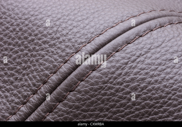 A brown leather background - Stock Image