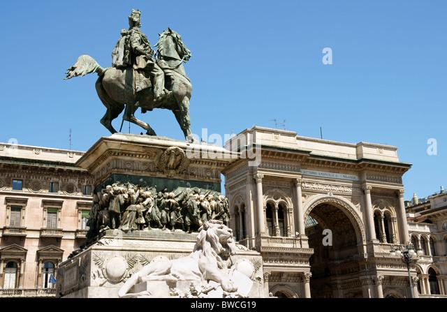 Galleria Vittorio Emanuele II and equestrian monument dedicated to the italian king in Piazza del Duomo, Milan. - Stock Image