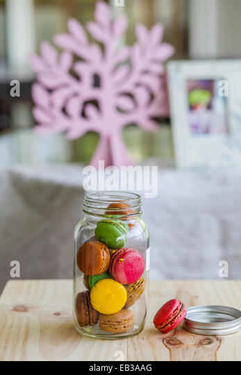 Macaroons in glass pot - Stock Image