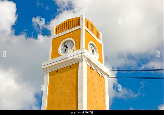Cozumel Mexico San Miguel town Parque Benito Juarez La Plaza bright yellow clock tower - Stock Image