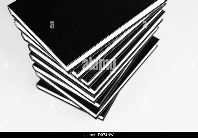 Many books in a pile black and white photo. - Stock Image