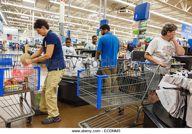 Springfield Illinois Walmart inside shopping discount department store checkout line queue cashier employees customers - Stock Image