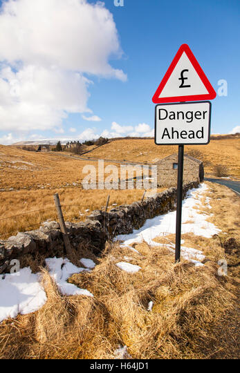 £ Pound dropping rising against other currencies economy exchange danger ahead sign signs worry about £ - Stock Image