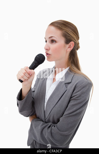 Side view of woman with microphone - Stock Image