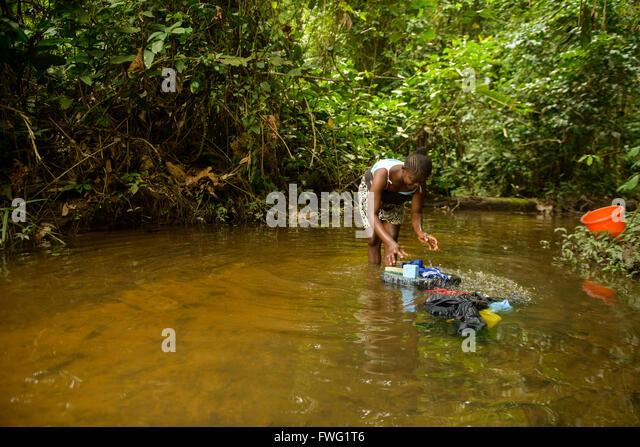 Woman washing clothes, Democratic Republic of Congo - Stock-Bilder