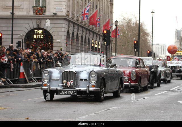 London, UK. 1st January 2017. Performers driving vintage cars seen participating in London New Year's Day Parade - Stock Image
