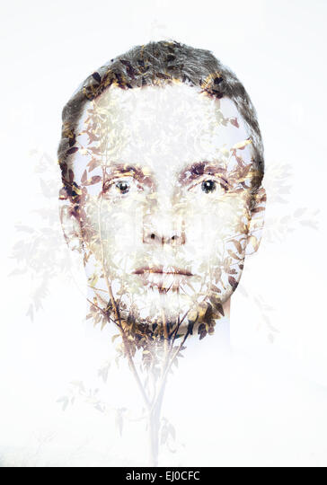 Double exposure abstract conceptual ecological collage, man face and small tree with leaves pattern - Stock-Bilder