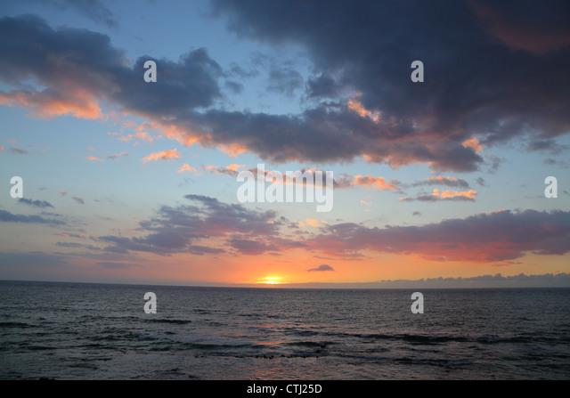 Sunset over Pacific Ocean, Big Island, Hawaii - Stock Image