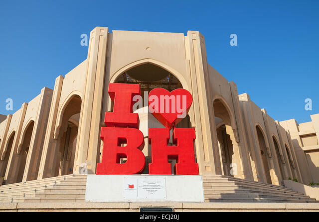 Manama, Bahrain - November 21, 2014: Red touristic construction with text I love Bahrain stands on the street of - Stock-Bilder