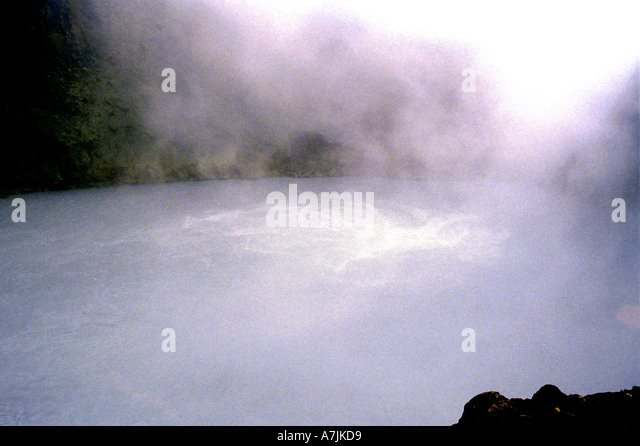 Dominica West Indies Caribbean Boiling Lake showing the boiling and steam - Stock Image