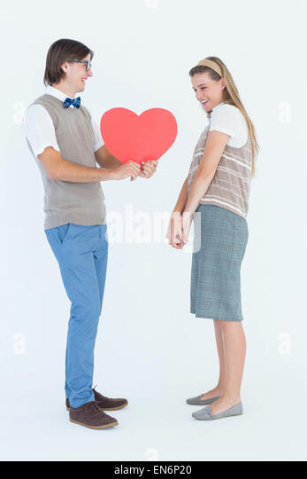 Geeky hipsters smiling at each other - Stock Image