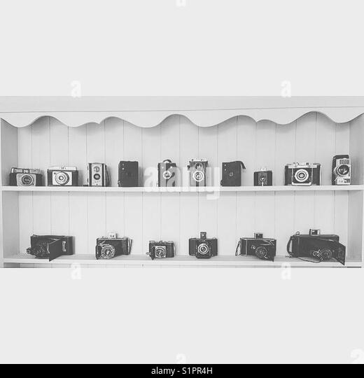 Old cameras on shelves - Stock Image