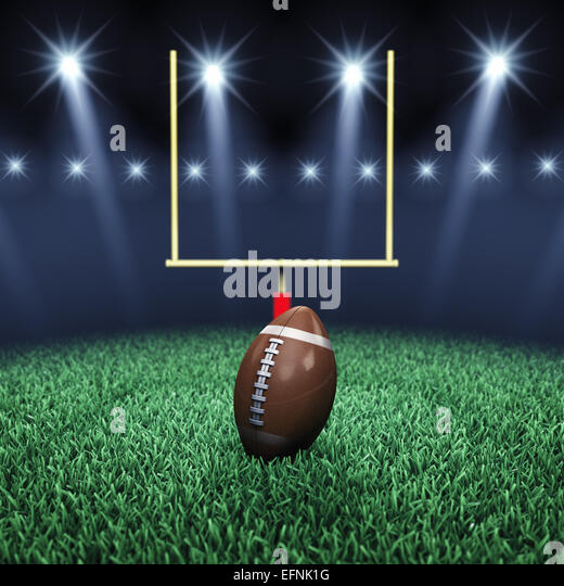 American football field , ball , goal post and floodlights , Sport arena - Stock Image