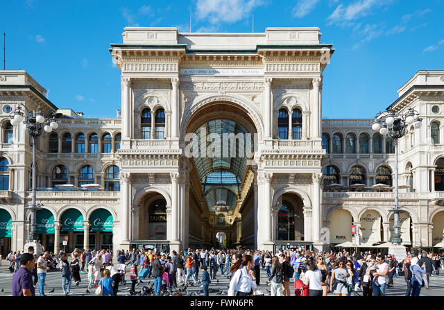 Milan Vittorio Emanuele gallery exterior view with people in a sunny day in Italy - Stock Image