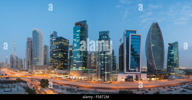 Skyline panorama of new office towers at night  in Business Bay district of Dubai United Arab Emirates - Stock-Bilder