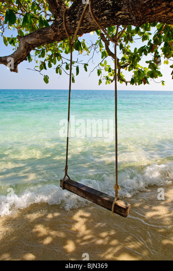 Swing on tropical sea beach - Stock Image