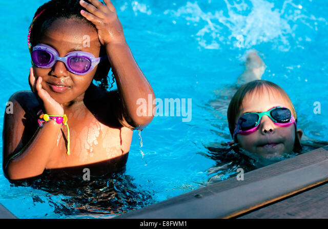 Two girls in a swimming pool - Stock Image