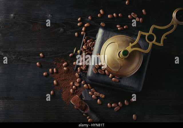 Roasted coffee beans over black - Stock Image