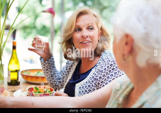Two women having lunch together at home - Stock Image