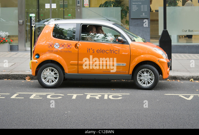 An electric car recharging at an electrobay, London , UK. - Stock Image