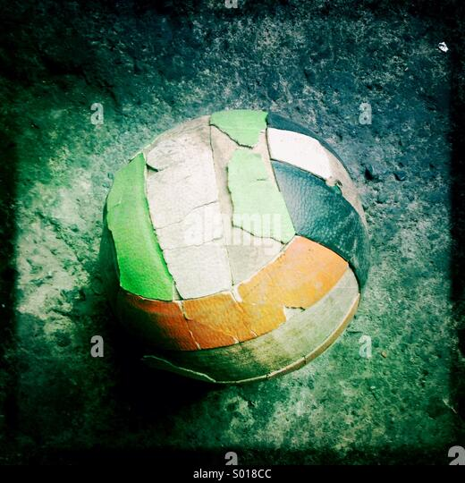 Old soccer ball on ground - Stock-Bilder