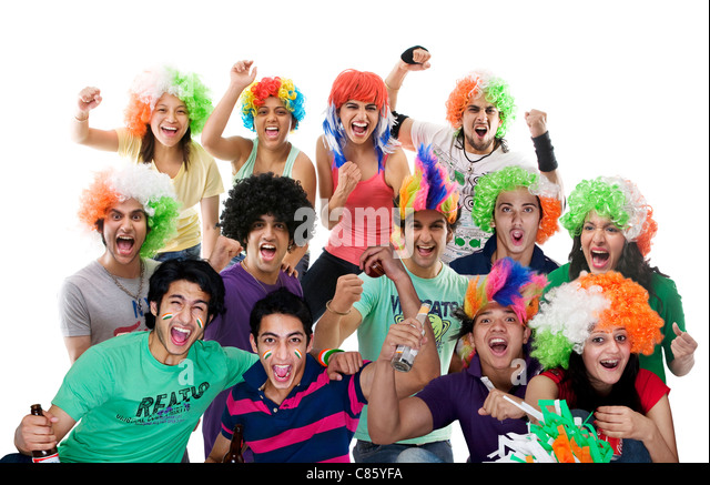 Portrait of youngsters with wigs cheering - Stock Image