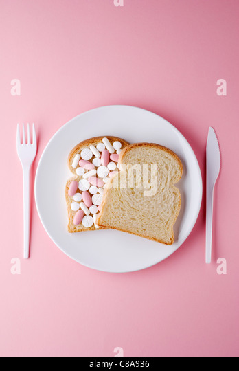 Bread sandwich filled with medecine - Stock Image