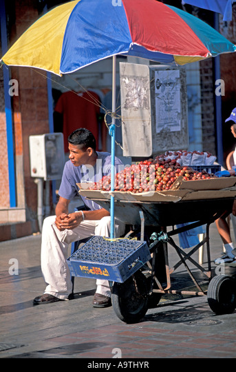 Isla Margarita island Venezuela Porlamar city vegetable seller vendor - Stock Image