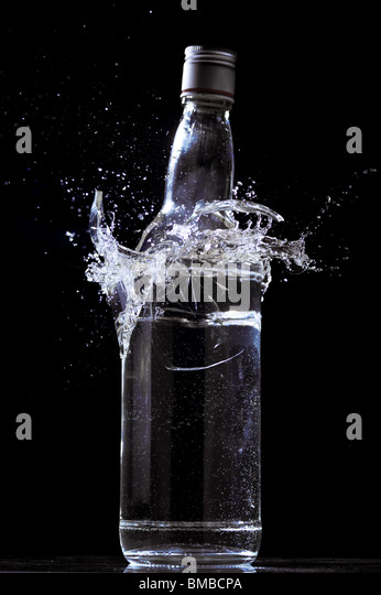 Full bottle breaking - Stock Image