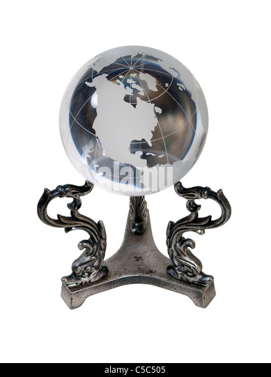 Crystal globe with the Americas showing on a silver stand - path included - Stock Image