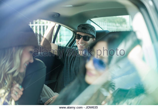 Group of friends on car journey together - Stock-Bilder