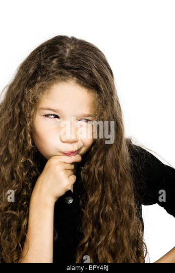 caucasian little girl portrait pucker  pensive thinking mistrust isolated studio on white background - Stock Image