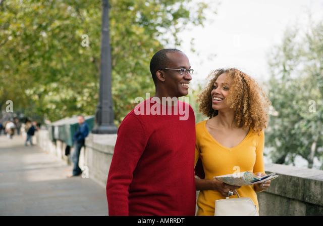 African couple walking - Stock-Bilder