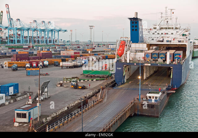 Cross Channel Ro Ro ferry waiting for commercial lorries to board at its berth in the Zeebrugge container port, - Stock Image