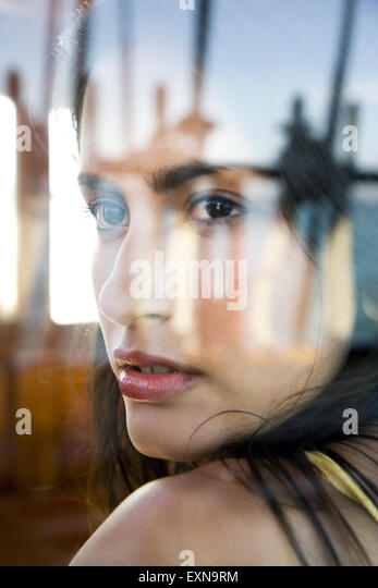 Young woman in cabin on a sailing ship - Stock-Bilder